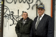 Two_Men_in_Front_of_Grafitti