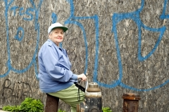 Woman_in_Front_of_Blue_Grafitti